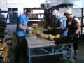Утренний хлеб вынимают из горячих форм и готовят к отправке в магазин